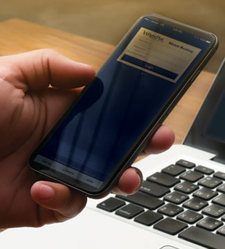 Hand using a cell phone. Mobile and online banking callout