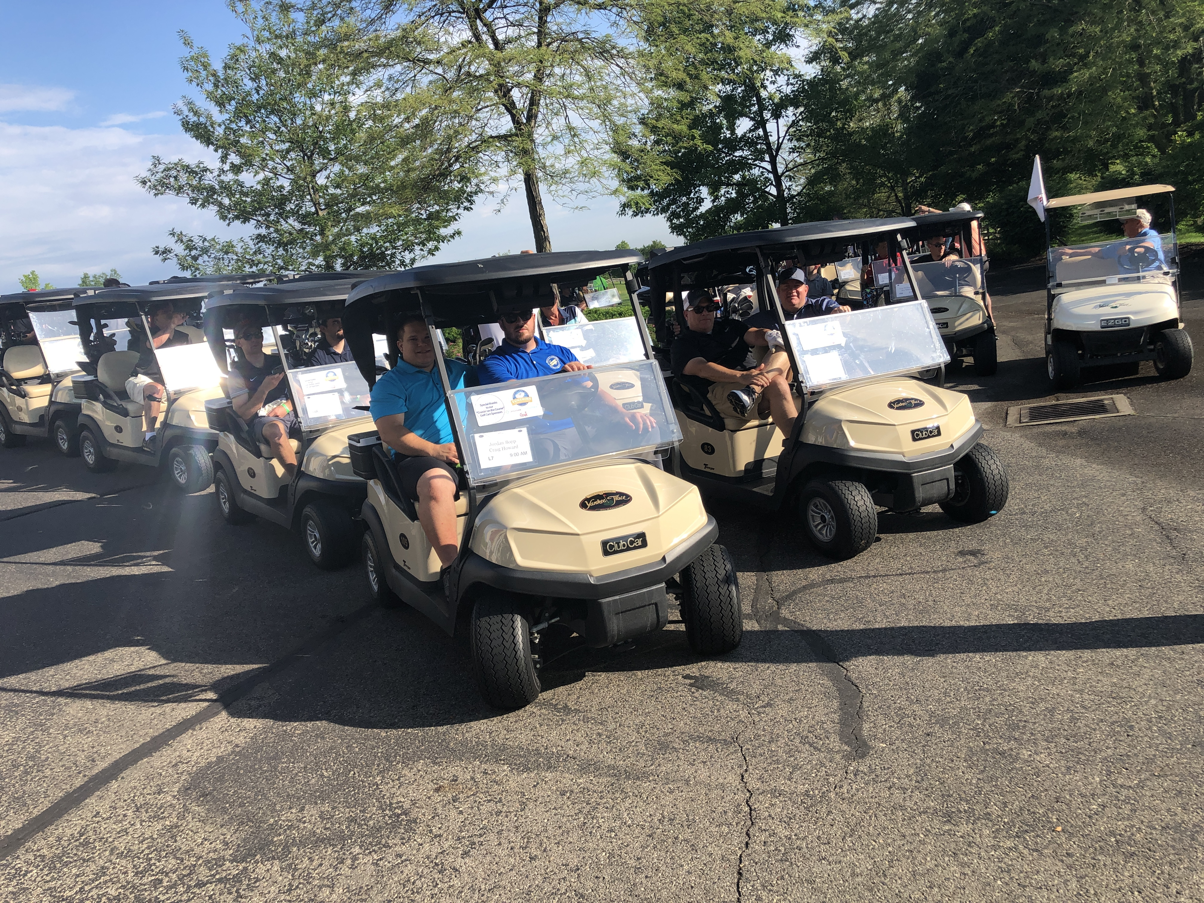Golfers riding on golf carts during the WPCU Golf Outing